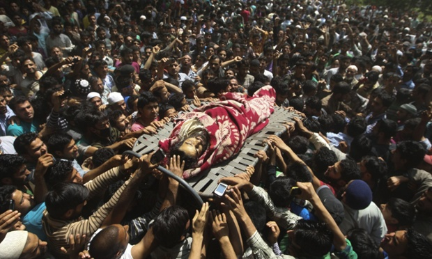 Villagers carry the body of Altaf Baba alias Gazi Baba, during his funeral procession. Photograph: Farooq Khan/EPA
