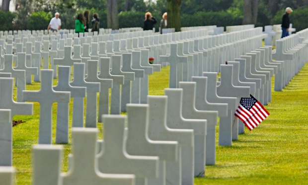 Visitors walk among the 9,387 graves at Colleville American military cemetery, western France, on the  69th anniversary of D-Day.