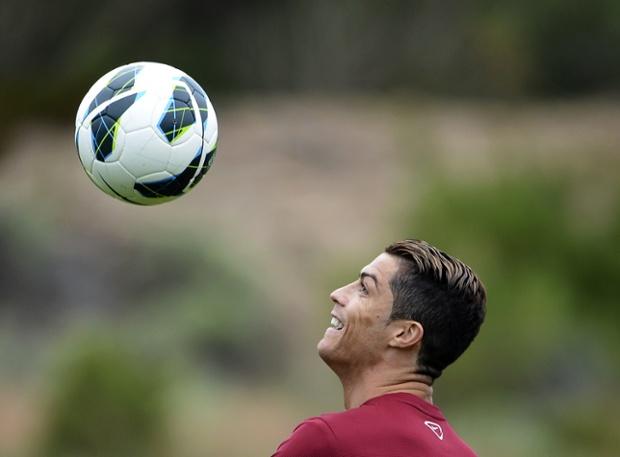 Portuguese forward Cristiano Ronaldo trains near Obidos, the day before Portugal's World Cup 2014 qualifier against Russia.