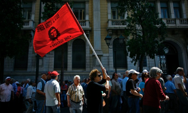 Greek pensioner waves a flag depicting Che Guevara during a protest against pension cuts in central Athens. In its annual report on the Greek economy, the International Monetary Fund admitted to mistakes in managing the Greek programme and said it considerably underestimated the effect of its measures on the Greek economy.