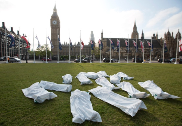 Protesters from Free Belarus Now, a group demanding the return of political prisoners in the eastern European country, pose in body bags outside the Houses of Parliament in London.