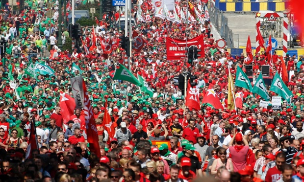 Tens of thousands of Belgian public sector workers, employees and trade union members protest against austerity measures during a march through central Brussels.