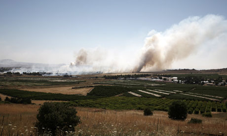 Smoke from clashes between Syrian rebels and regime forces near Quneitra crossing of Golan Heights