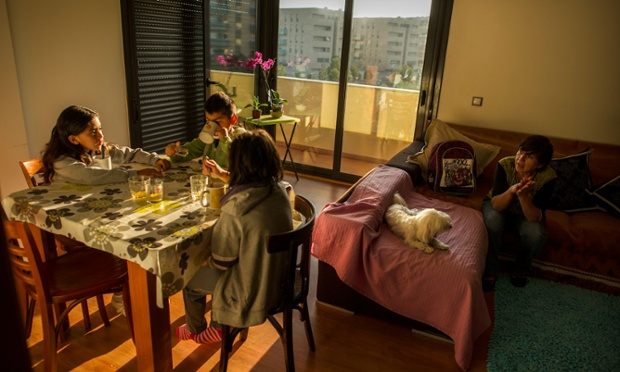 Children have breakfast at an apartment in a newly constructed building, where they live with their grandmother after they were evicted for failing to pay rent while living on her pension in Salt, Spain. With as many as one million properties unsold, many victims of Spain's financial crisis have turned to squatting in empty buildings.