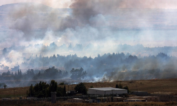 Smoke caused by shelling rises on the Syrian side of the border, next to the Israeli-Syrian border crossing of Quneitra, in the Golan Heights.