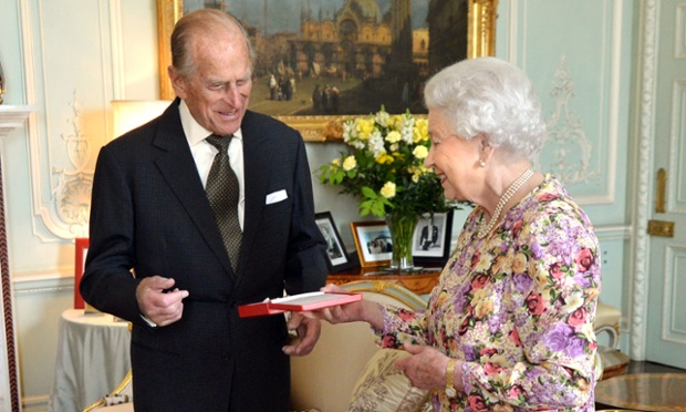 The Queen presents her husband, the Duke of Edinburgh, with New Zealand's highest honour, the Order of New Zealand, at Buckingham Palace.