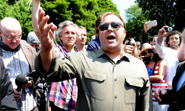 American radio host, author, conspiracy theorist and documentary filmmaker Alex Jones speaks to the media outside the Grove Hotel, in Watford, where the annual Bilderberg Group summit meeting is being held.