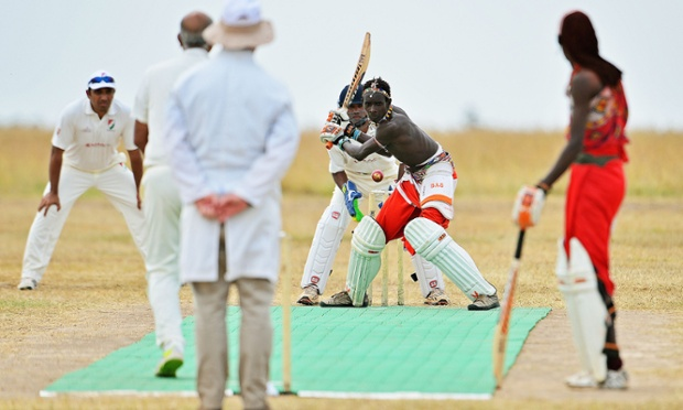 A Maasai cricketer goes up to bat as the Maasai Cricket Warriors play a Twenty20 match against the Ambassadors, in Laikipia national park, Kenya. The Maasai Cricket Warriors play exhibition matches to highlight issues in rural communities. The team are hoping to raise funds through sponsorship to play in the Last Man Stands tournament at Lords.