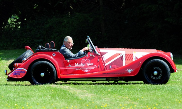Looking good: Prince Charles drives a Morgan Plus 4 during a visit to the Morgan Motor Company at Malvern, Worcestershire.