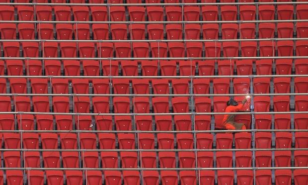 A worker welds handrails inside the Mane Garrincha National Stadium in Brasília. Photograph: Uselei Marcelino/Reuters