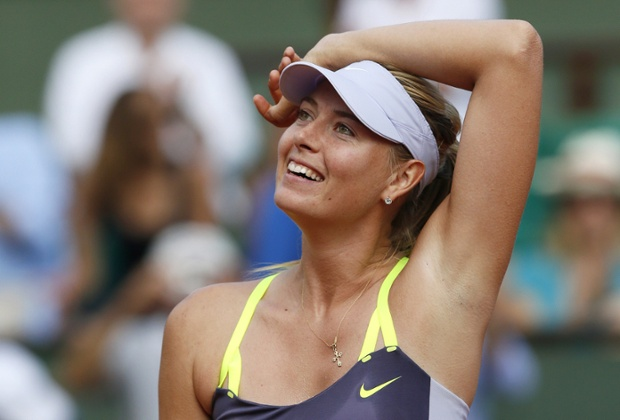 Russia's Maria Sharapova celebrates after winning against Belarus' Victoria Azarenka after the French Open semi-final at the Roland Garros stadium in Paris.