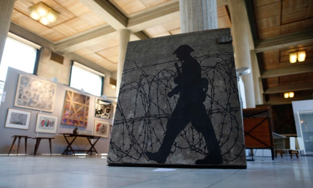A painted slab from the Berlin Wall, entitled 'A concrete memory, 1998' by artist Gerard Fromanger, is displayed at the exhibition On/Off Berlin Wall, part of the historical Sylvestre Verger Collection in Paris. The collection of 48 concrete sections of the former Berlin Wall, under the name of Artists for Freedom, will be auctioned today. Photograph: Benoit Tessier/Reuters