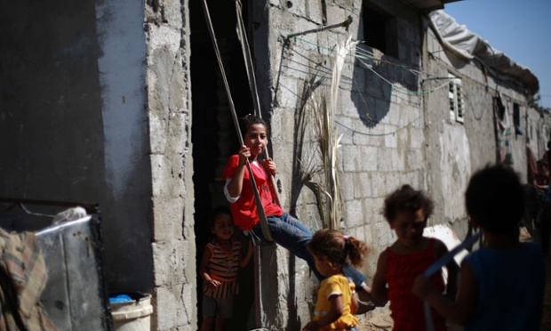 Palestinian refugee children play in a poverty-stricken quarter, south of Gaza City.