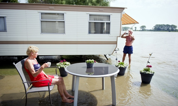 It's brightening up: A couple are determined to enjoy their holiday at a flooded campsite near Gendt, The Netherlands.