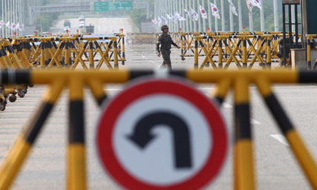 A South Korean soldier patrols on Unification bridge,