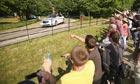 Demonstrators protest against people arriving for the Bilderberg group summit in Watford