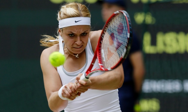 Sabine Lisicki returns to Serena Williams.