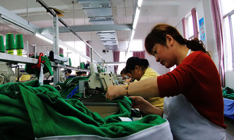 Chinese workers sew garments at a factory in Jiangxi province