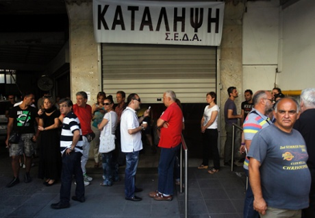 Municipal employees have occupied a municipal building in central Athens protesting a government's decision for suspension and possible future lay off of public servants, in Athens, Greece, 10 July 2013.