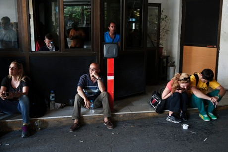 Athens' municipal employees take part in a protest outside the town hall of Athens July 10, 2013.