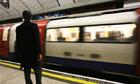 A man waits for a Northern Line underground train