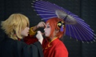 Cosplay fans get ready on the opening day of the 9th China International Comics Games Expo in Shanghai