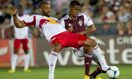 Jaime Castrillon of the Colorado Rapids, wrestles with Thierry Henry of the New York Red Bulls
