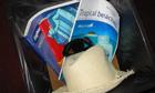 holiday brochures, sunglasses, hat in bin