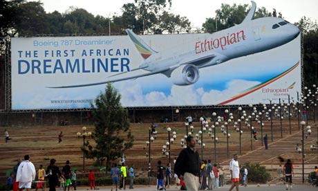 People walk past a billboard of an Ethiopian Airlines Boeing 787 Dreamliner plane in Addis Ababa