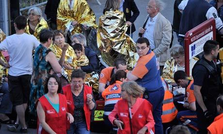 Rescuers and passengers at scene of train derailment in Bretigny-sur-Orge