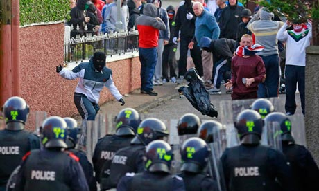 Loyalists clash with police in the Woodvale Road area of Belfast