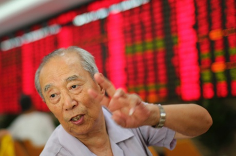 An investor gestures at a private securities company on Monday July 15, 2013 in Shanghai, China.
