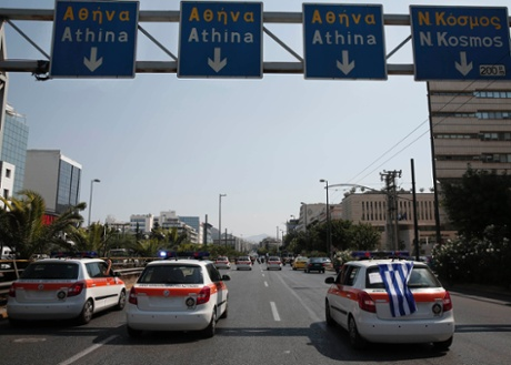 Municipal police officers take part in a protest with motorbikes and cars against public sector layoffs, which the government has promised its international lenders in exchange for bailout funds, in Athens July 15, 2013.