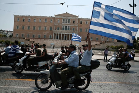 Municipal police officers take part in a protest with motorbikes against public sector layoffs, which the government has promised its international lenders in exchange for bailout funds, in Athens July 15, 2013.
