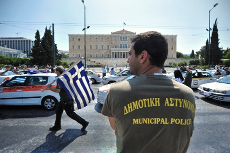 Municipal police officers protest in front of the  Parliament in Athens, Greece, 15 July 2013.