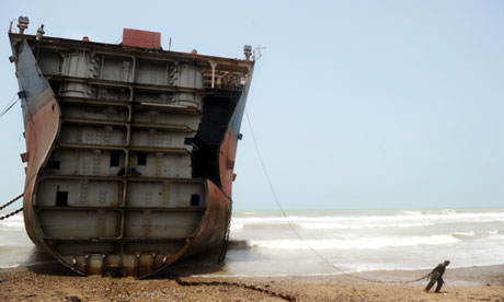 One of the 127 ship-breaking plots in Gadani, 40km west of Karachi, Pakistan. Gadani's ship-breaking yards employ some 10,000 workers including welders, cleaners, crane operators and worker supervisors. Photograph: Roberto Schmidt/AFP/Getty Images