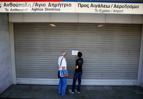 Commuters read a notice at the closed entrance of central Syntagma square station during a general strike in Athens July 16, 2013.