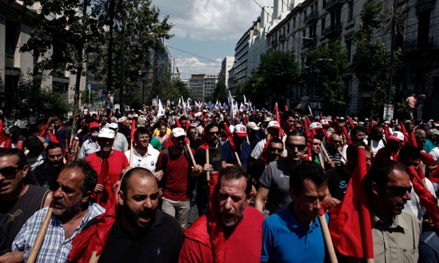 Greek communist union PAME members shout slogans against the Greek government during a general strike in Athens on July 16, 2013.