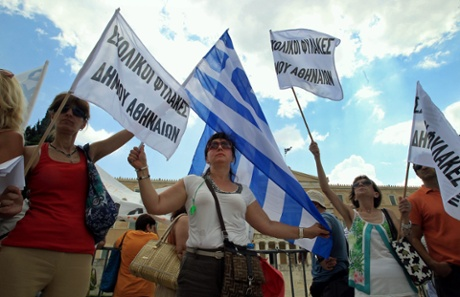 Protesters hold flags in front of the Greek Parliament during a demonstration in central Athens, Greece, 16 July 2013.
