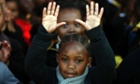 Children at the Denver Primary School in Johannesburg, South Africa, sing happy birthday and pray for Ailing former South African President Nelson Mandela on the occasion of his 95th birthday.