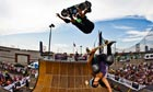 Legendary skateboarder Tony Hawk flies over Lizzie Armanto