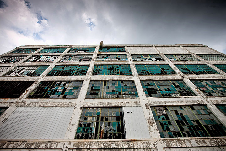 motor city blues: The broken windows of an abandoned factory