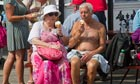 An elderly couple enjoy an ice cream on Brighton Pier