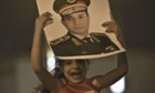 An Egyptian man carryie his daughter on his shoulders as she holds a picture of army chief and Defense Minister Gen. Abdel Fattah al-Sisi during a demonstration outside the presidential palace in Cairo calling for the ouster of President Mohamed Morsi on July 1, 2013. Egypt's armed forces warned that it will intervene if the people's demands are not met within 48 hours, after millions took to the streets to demand the president's resignation. AFP PHOTO / KHALED DESOUKIKHALED DESOUKI/AFP/Getty Images