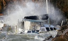 A large catamaran smashes against rocks following gale force winds in Hobart, Tasmania