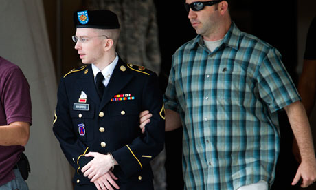 Army Pfc Bradley Manning is escorted out of a courthouse in Fort Meade, Maryland. Photograph: Jose Luis Magana/AP