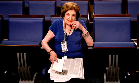 Long-time White House correspondent Helen Thomas taking up her seat
