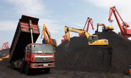 A truck unloads imported coal at a port in Lianyungang, in the Jiangsu province, China.