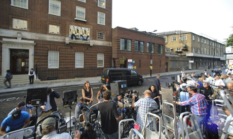 The press gather outside the Lindo Wing of St Mary's hospital, where the Duchess of Cambridge will give birth to the royal baby on 22 July 2013.