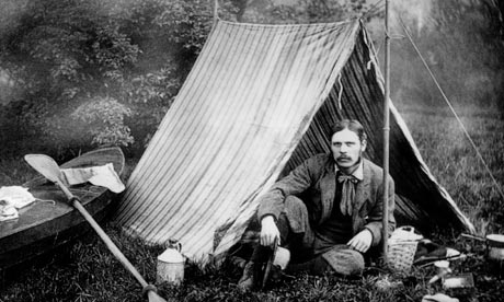 Thomas Hiram Holding camping with his tent and canoe
